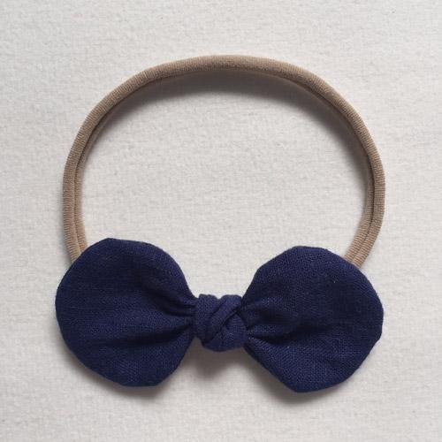 Βρεφική κορδέλα με μπλε σκούρο φιόγκο